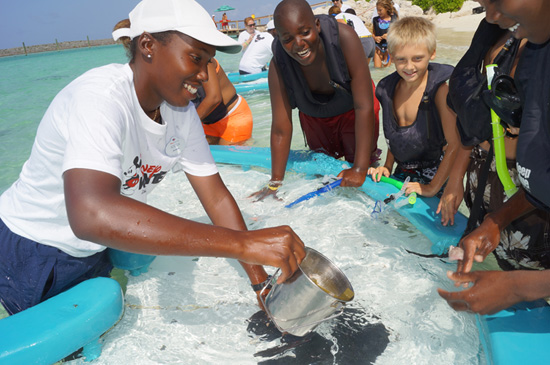 Children from the Abaco Islands exploring ways to learn to care about the environment at Disney's private island, Castaway Cay