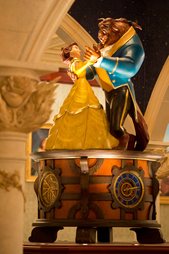 The centerpiece of the room is a lovely seven-foot-tall music box  of Belle and Beast