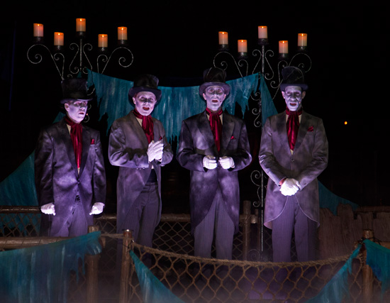 the Cadaver Dans, performing from their bewitched barge along the Rivers of America