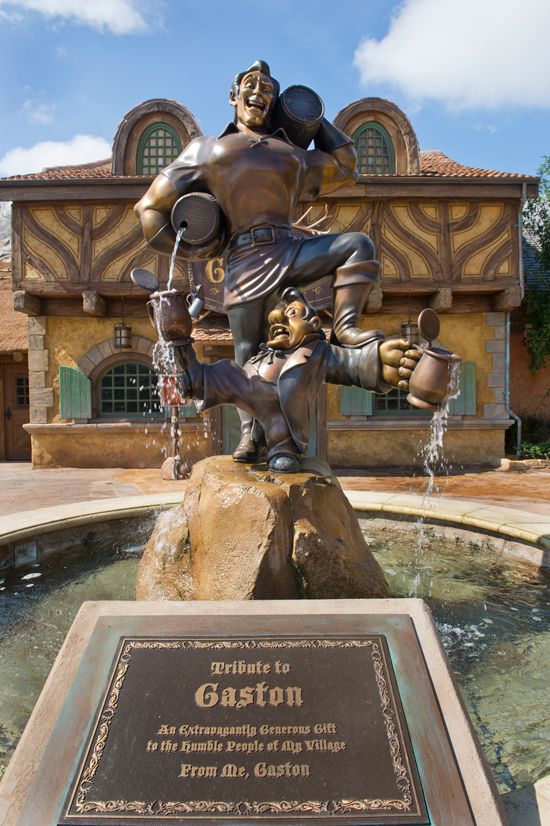 in front of Gaston's Tavern, is a fountain of Gaston and his sidekick, LeFou