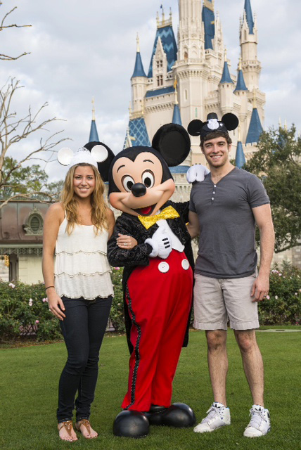 Broadway actor Corey Cott and his wife Meghan with Mickey Mouse at the Walt Disney World Resort