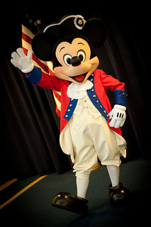 It's red, white and blue as Disney Parks salutes America with a 4th of July Fireworks Party — for an entire week, with patriotic lighting bathing the Disney castles on both coasts. Mickey Mouse appears in his patriotic finest and guests will find special USA shirts,