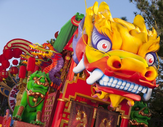"""The """"Chinese New Year"""" float celebrates the beginning of the Chinese calendar year, complete with traditional paper lanterns and a huge, ornate dragon flying above."""